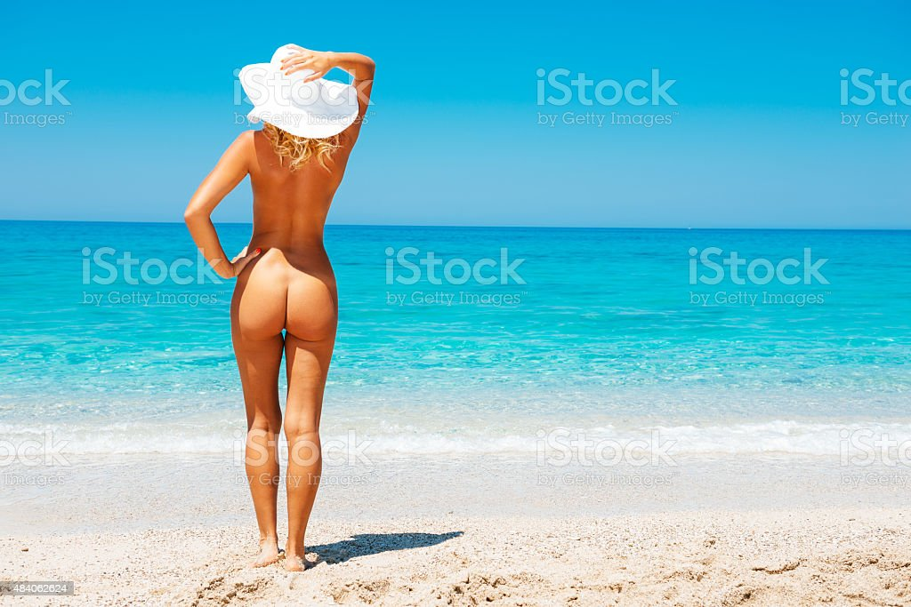 Girls tanning on the beach naked